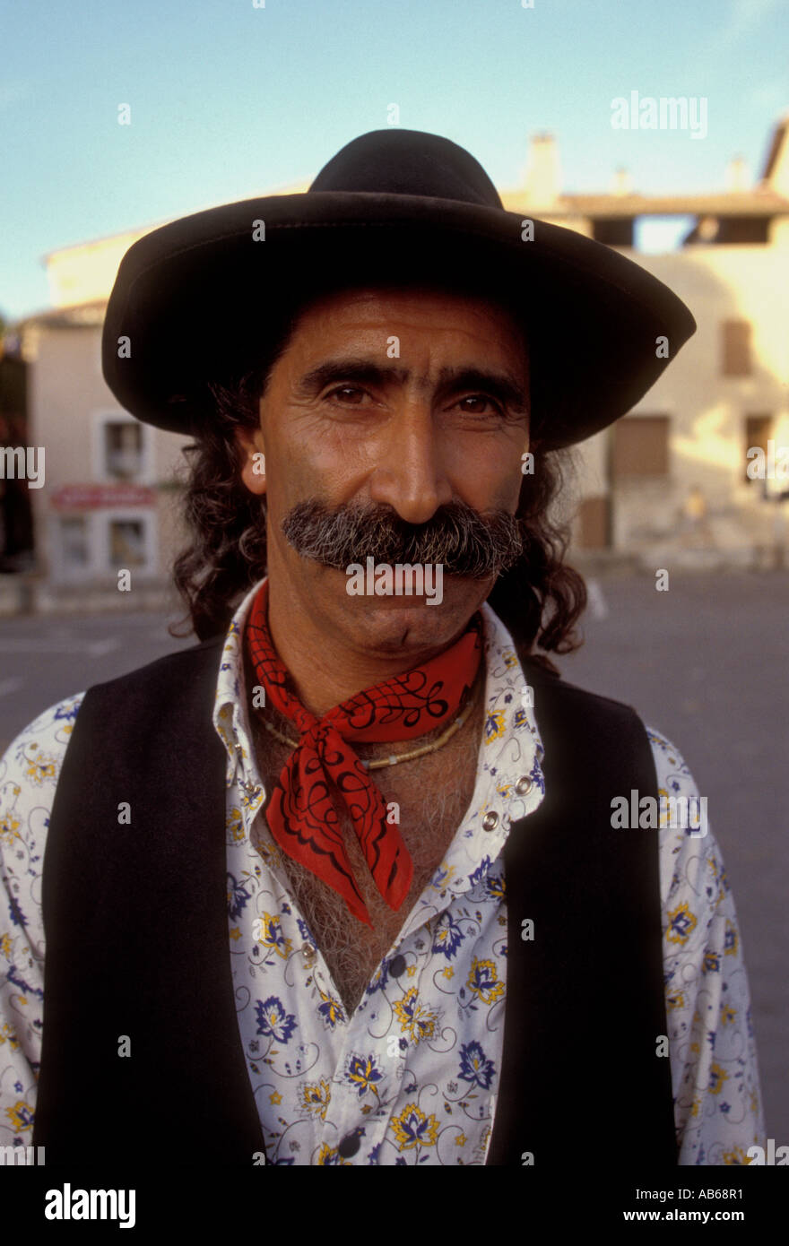 1, one, Frenchman, French man, eye contact, front view, head and shoulders, portrait, festival, town, Pernes-les-Fontaines, Provence, France - Stock Image