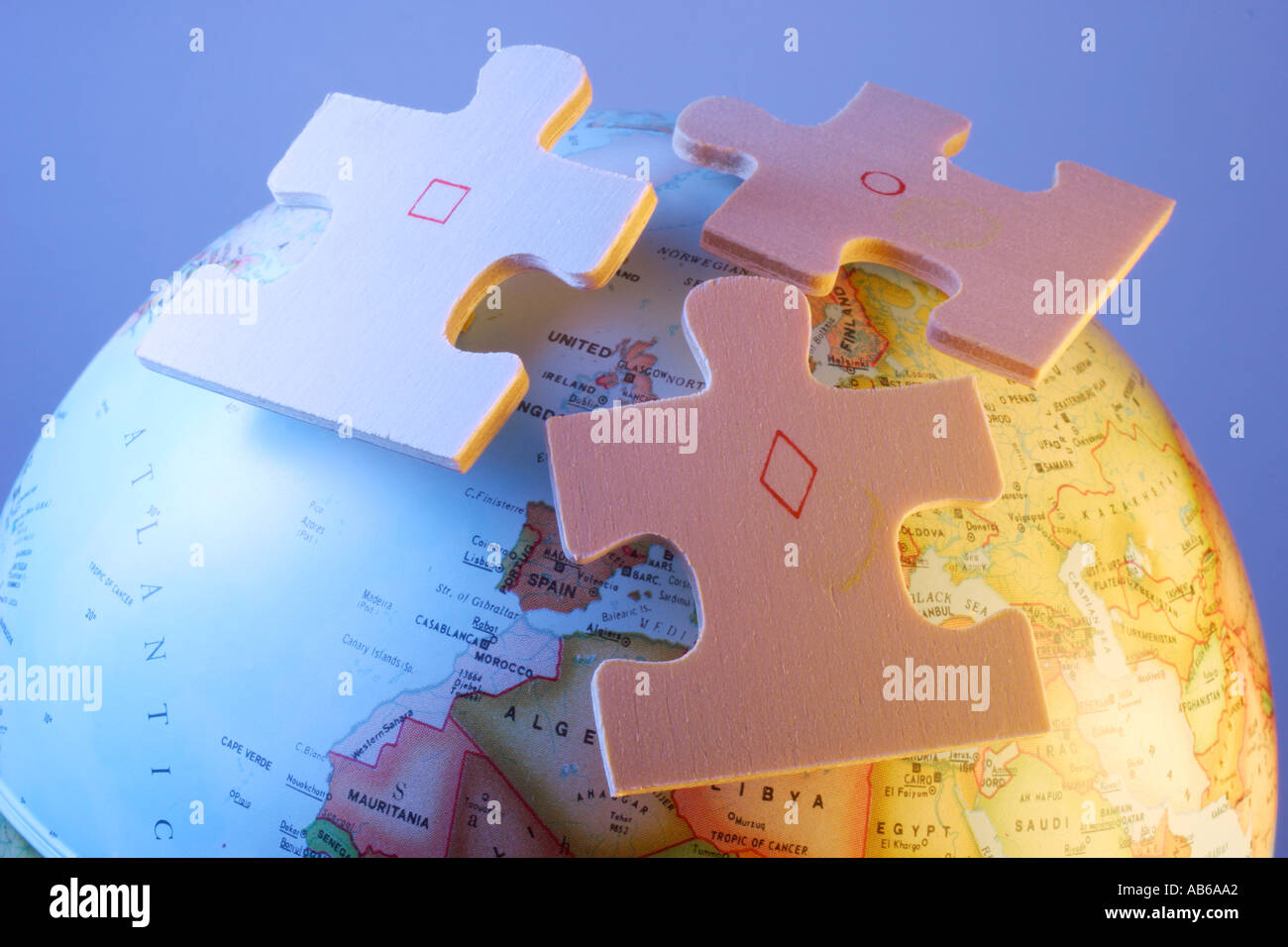 Globe jigsaw puzzle pieces stock photos globe jigsaw puzzle pieces globe with jigsaw puzzle pieces stock image gumiabroncs Image collections