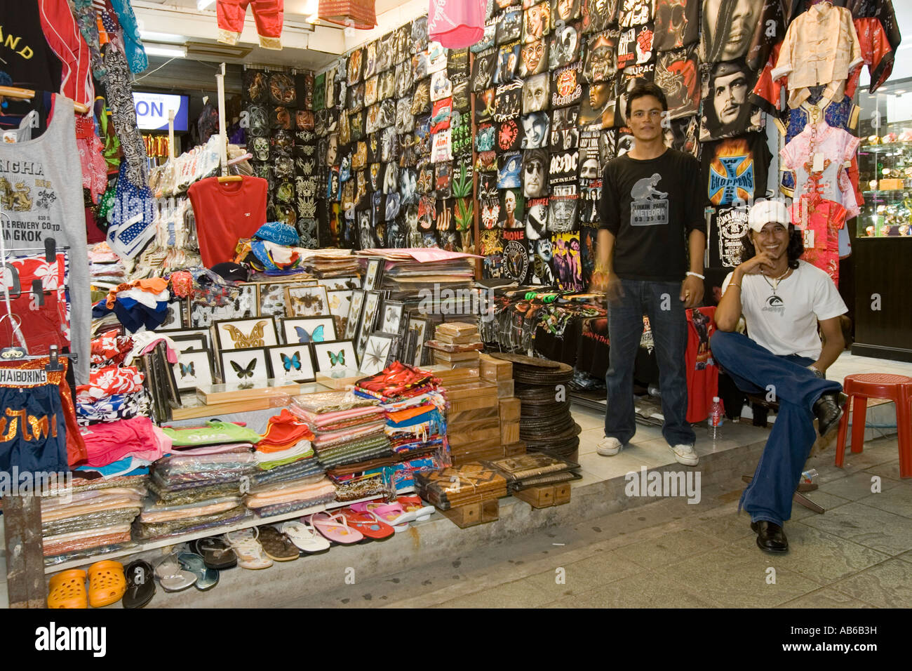 Young male assistants at T shirt shop Bangla Road Patong Beach Thailand Stock Photo