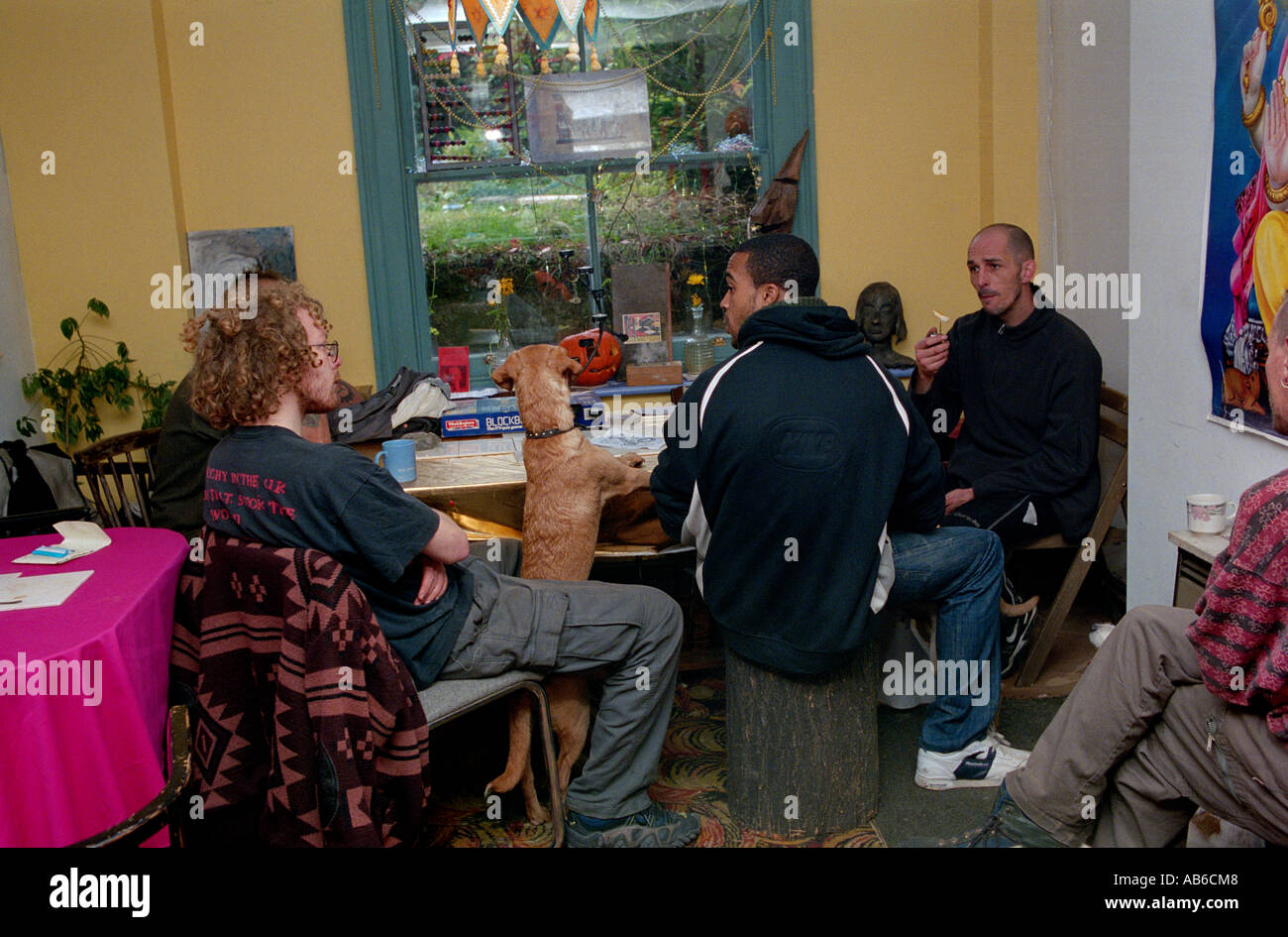 People socialising Cafe at St Agnes Place Squat Kennington South London. - Stock Image