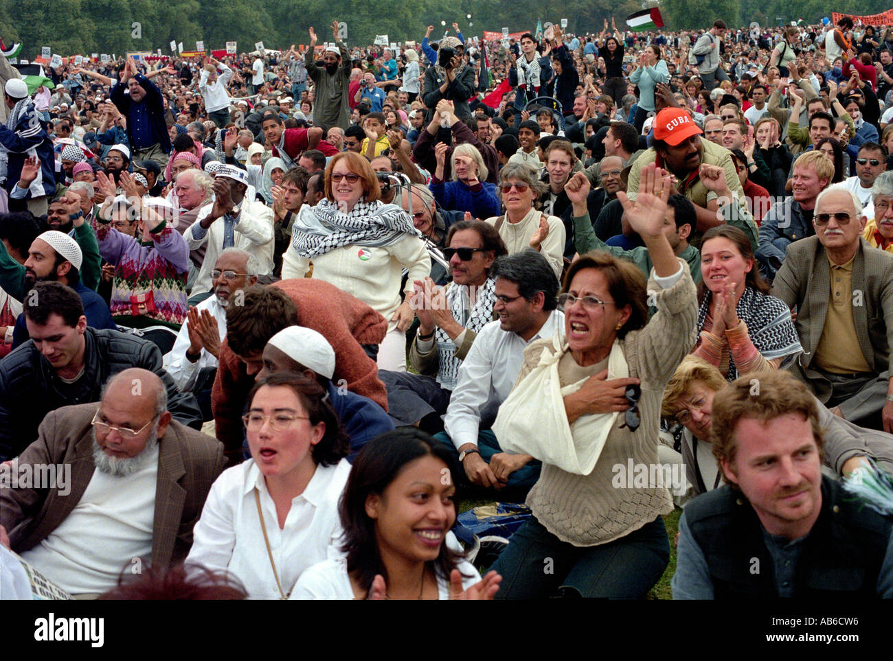 Large multicultural crowd of people in Hyde Park for a rally. - Stock Image