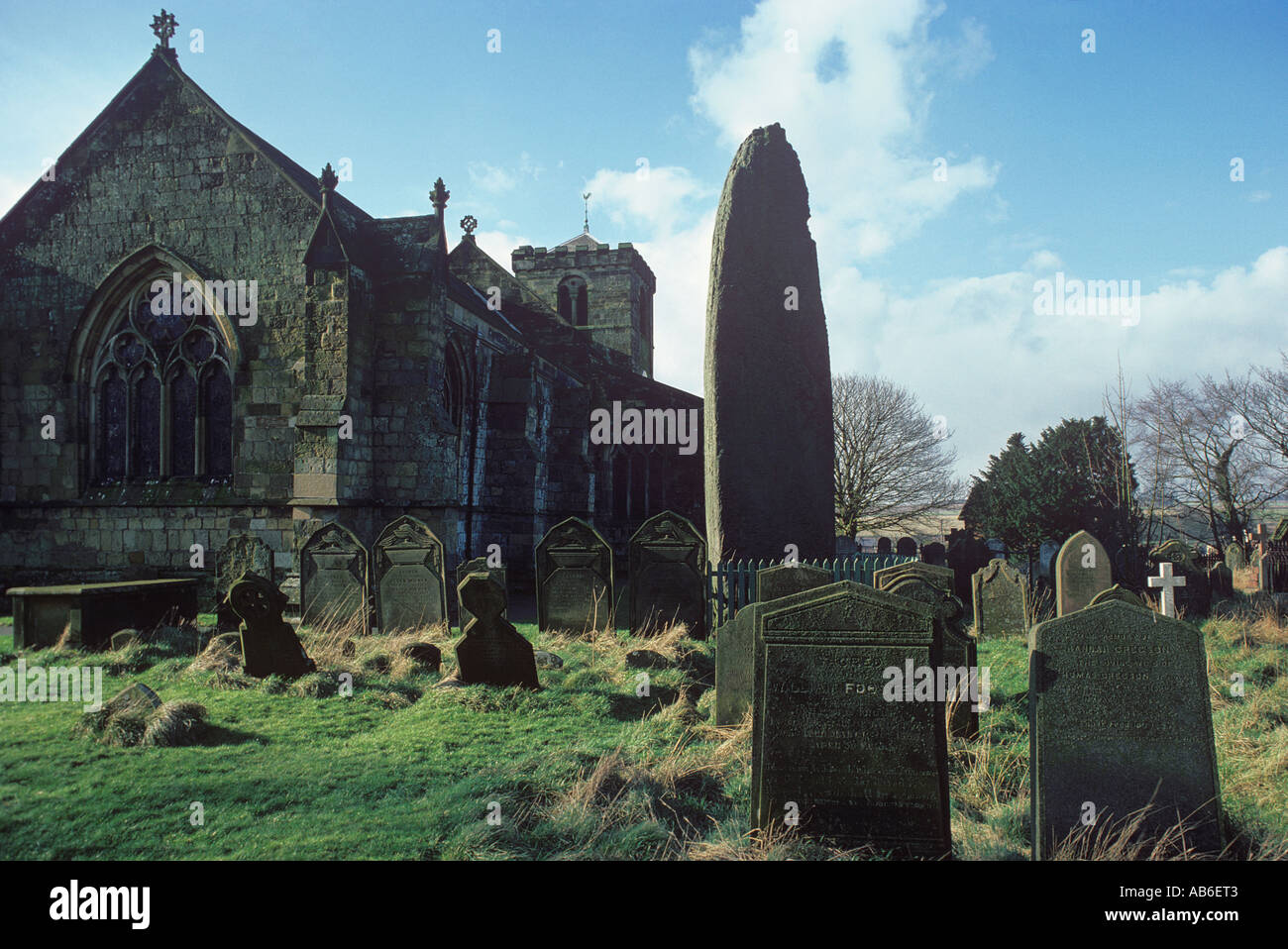 The tallest standing stone in Britain rises 25 feet 4 inches from the churchyard of All Saints Church Rudston in East Yorkshire - Stock Image