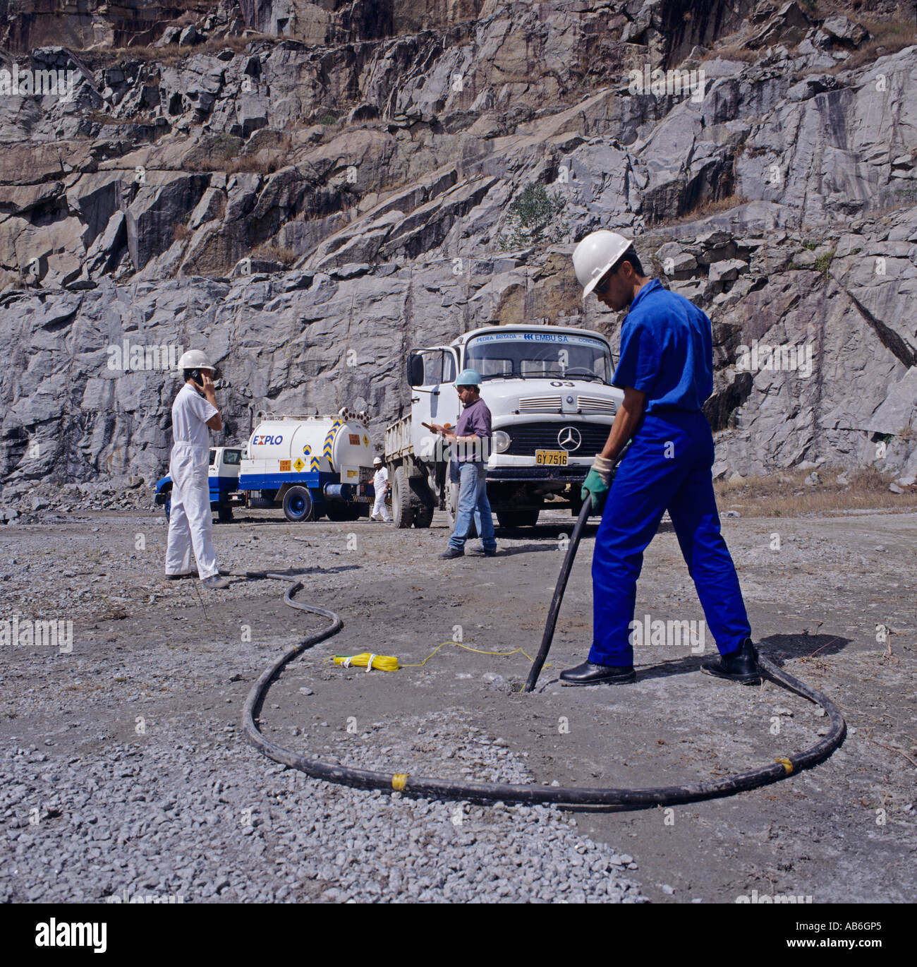 Drilling holes for explosives in mining industry, Brazil - Stock Image