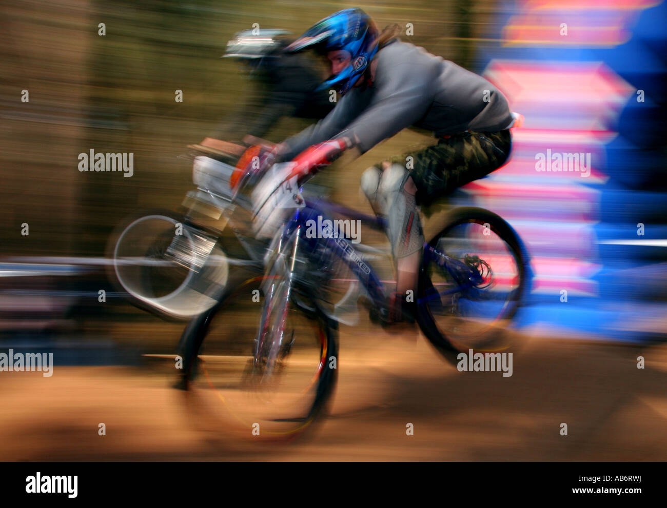 Two riders land after a jump at the NPS 4X championship round at Chicksands, Bedfordshire, 2007. - Stock Image