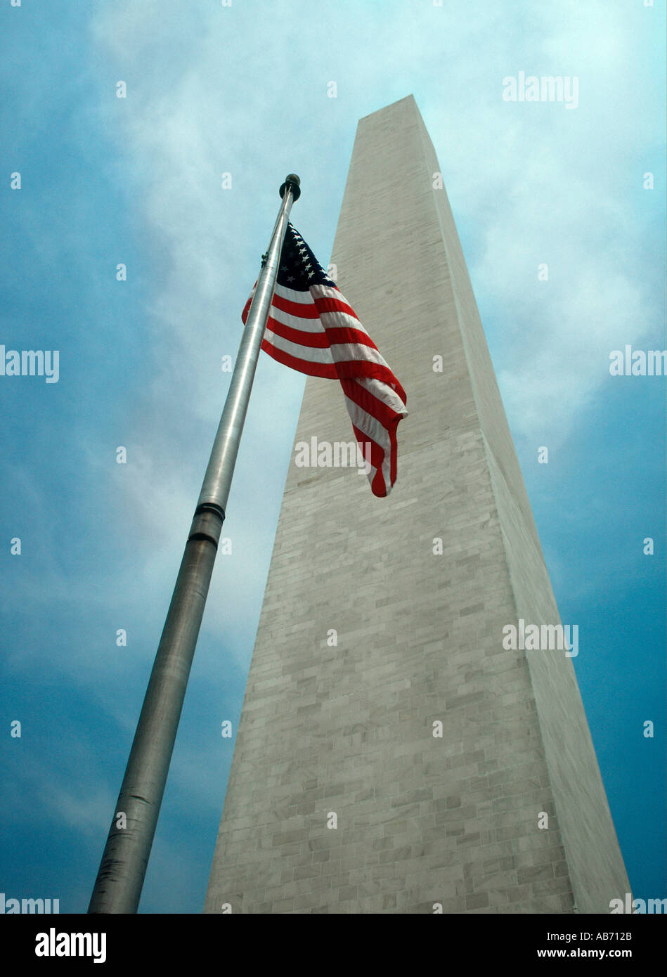 GEORGE WASHINGTON MONUMENT WITH STARS AND STRIPES FLAG - Stock Image