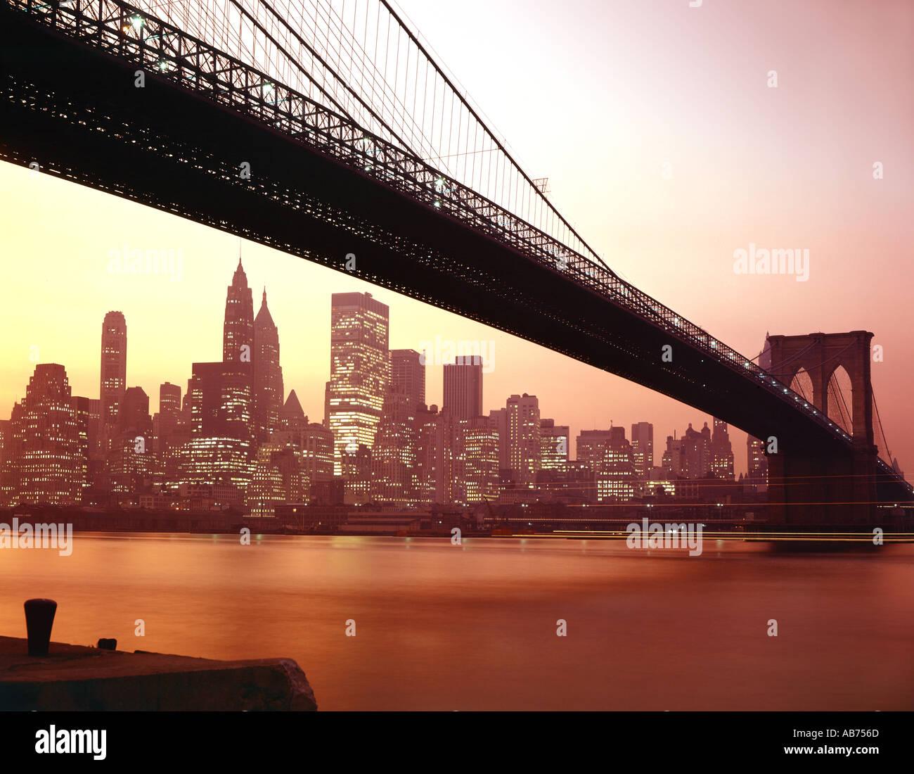 New York City and Brooklyn Bridge at dusk - Stock Image