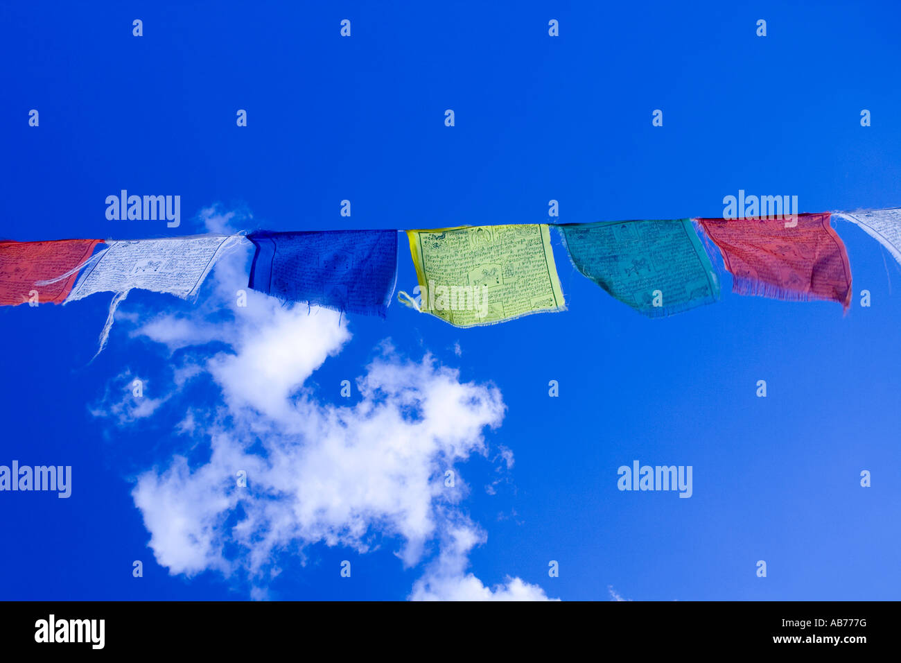 colourful bunting prayer flags - Stock Image