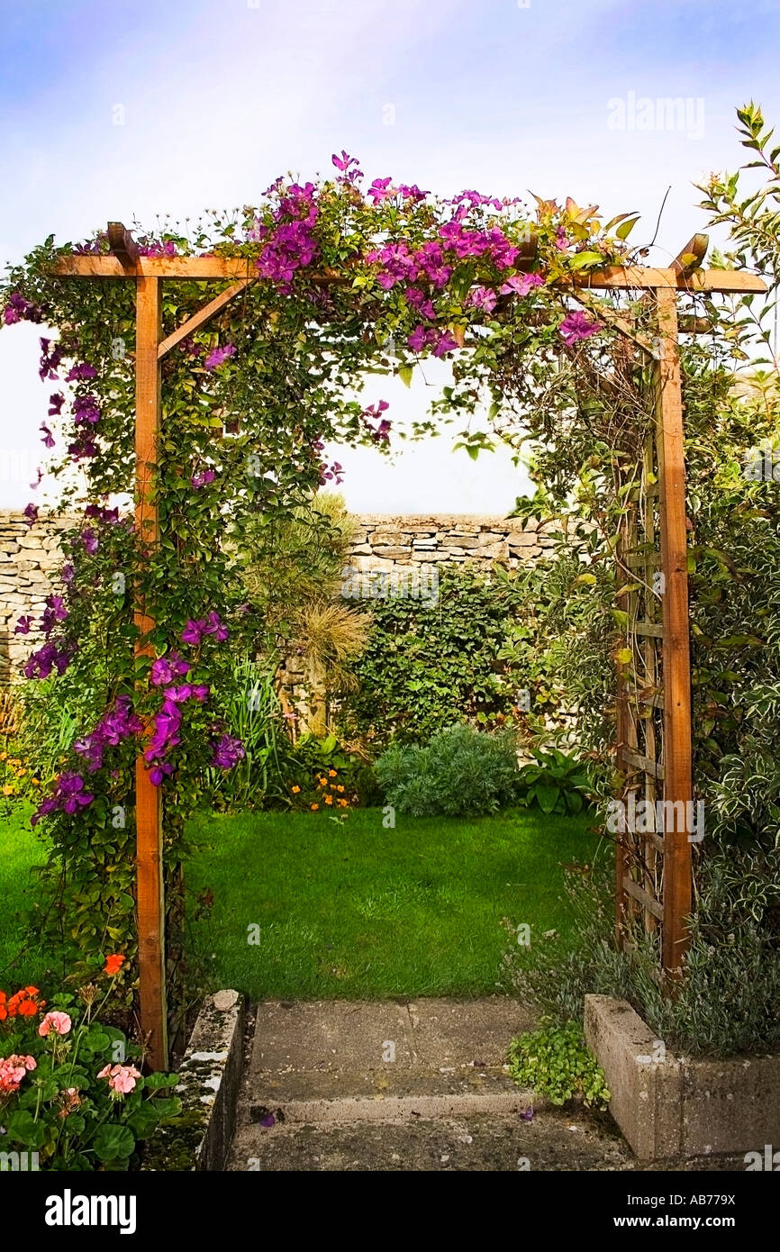 trellis arch in pretty english country garden Stock