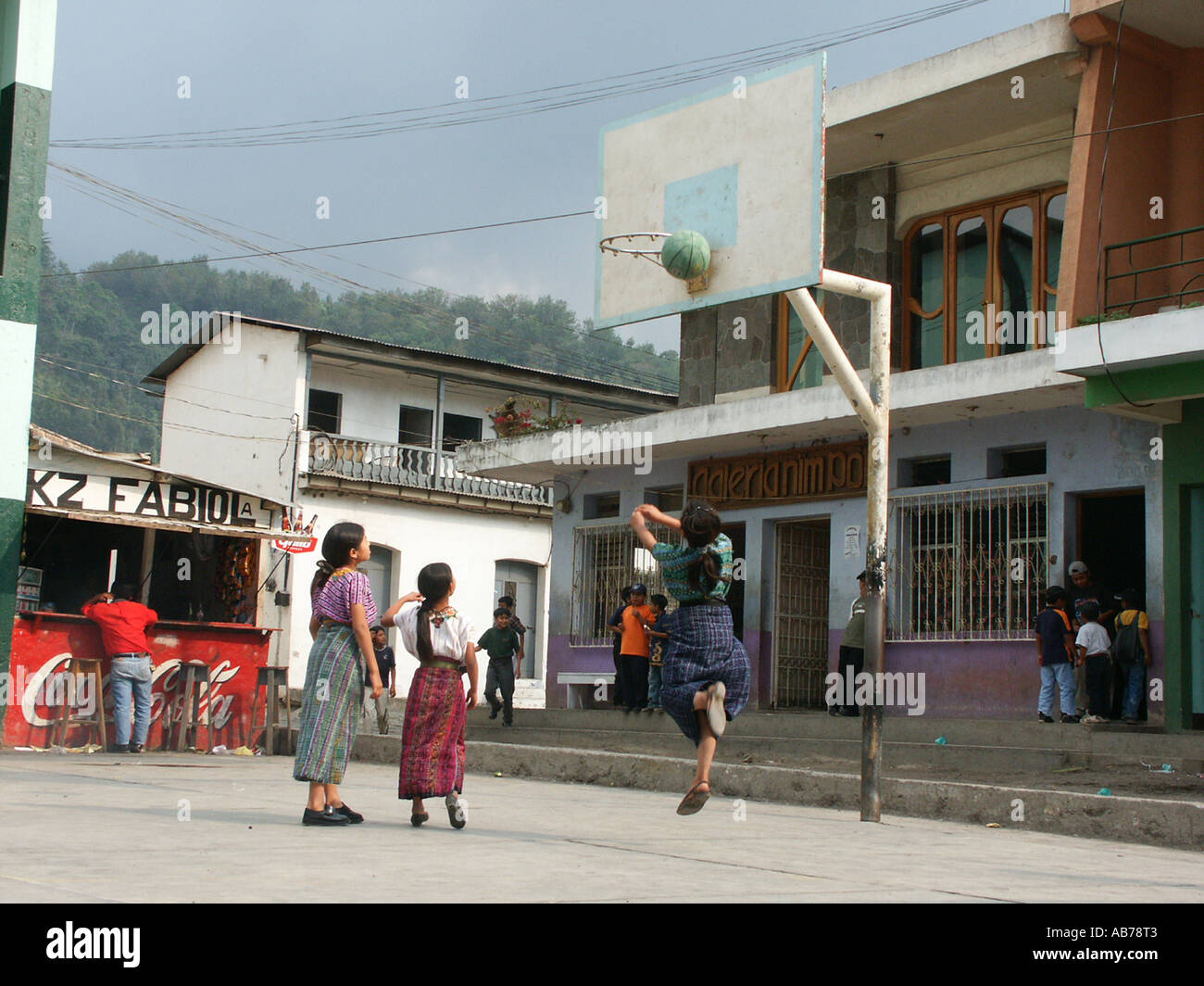 Indigenous children playing basketball in Santiago de Atitlan, Lake Atitlan, Guatemala Stock Photo