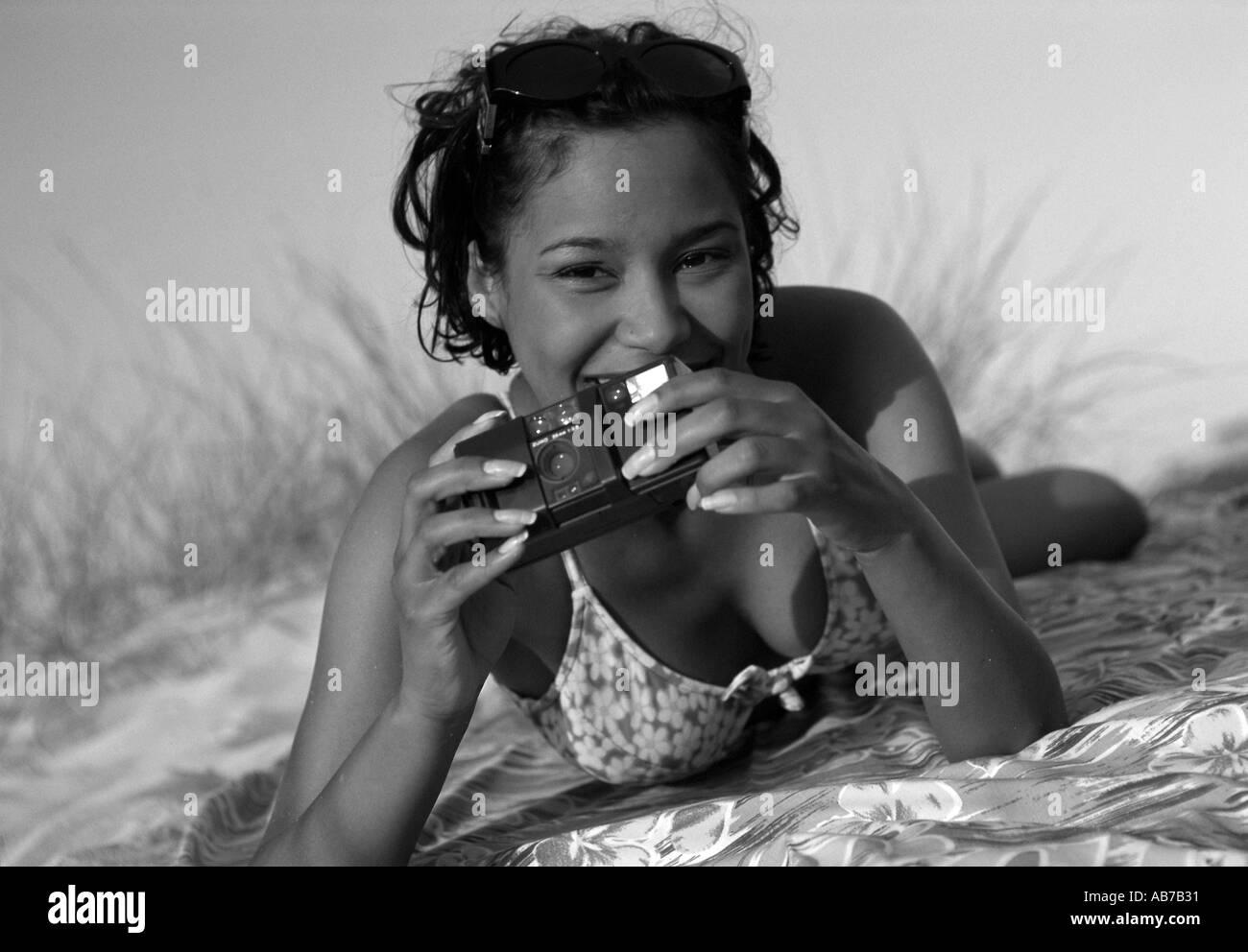 Woman on beach - Stock Image