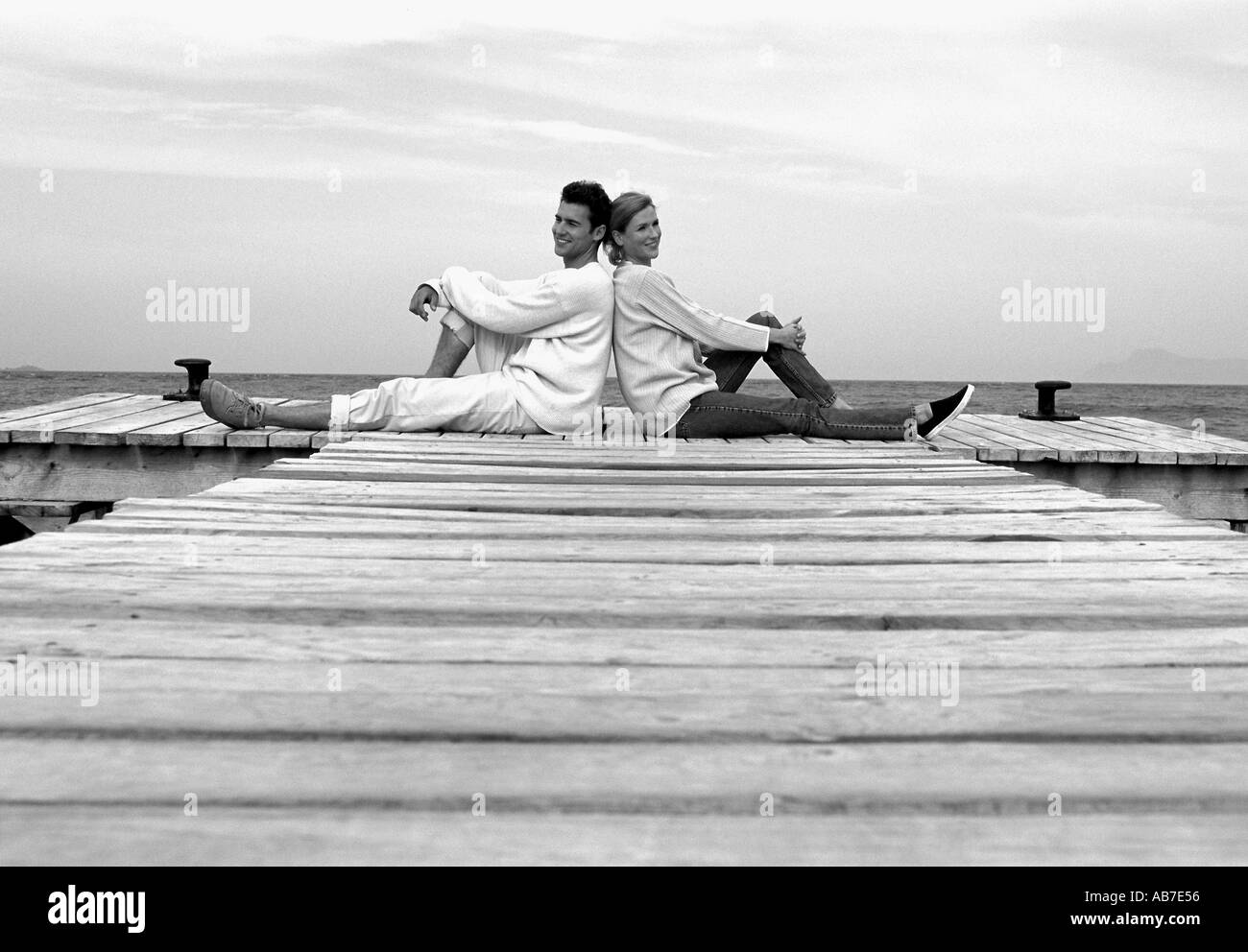 Couple on pier - Stock Image