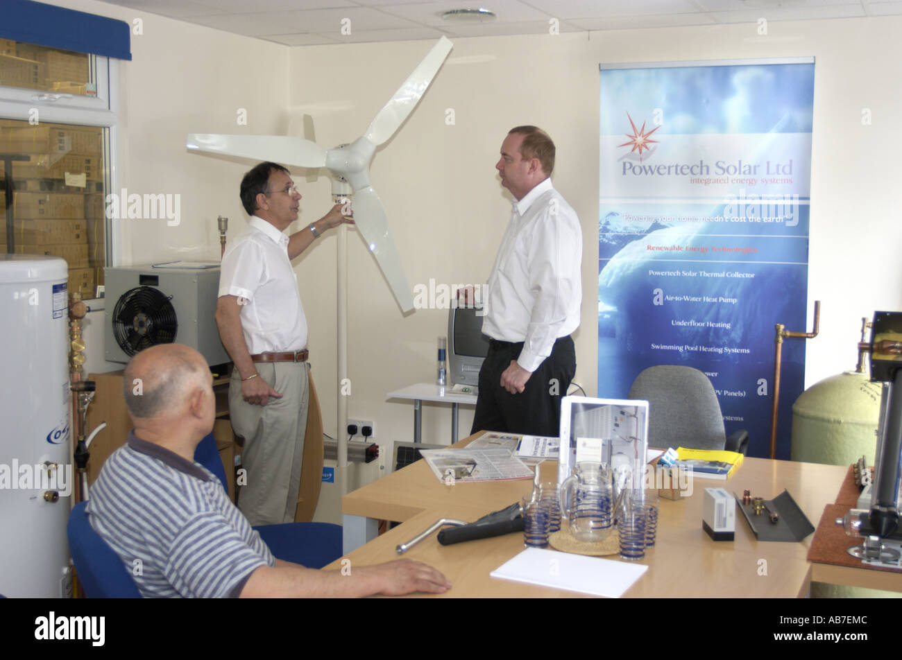 Techinicians being instucted in the instalation and use of Micro Wind Turbines and other micro power systems at Powertech Solar - Stock Image