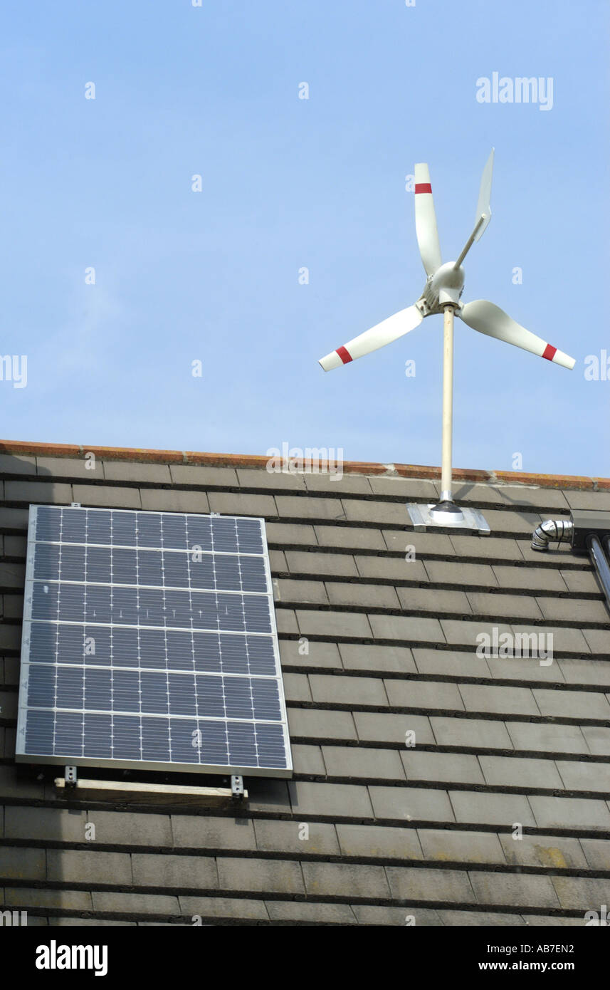 Micro Wind Turbine evacuated tube photo voltaics cells on house in Ferndown Dorset England supplied by Powertech Solar Ltd - Stock Image