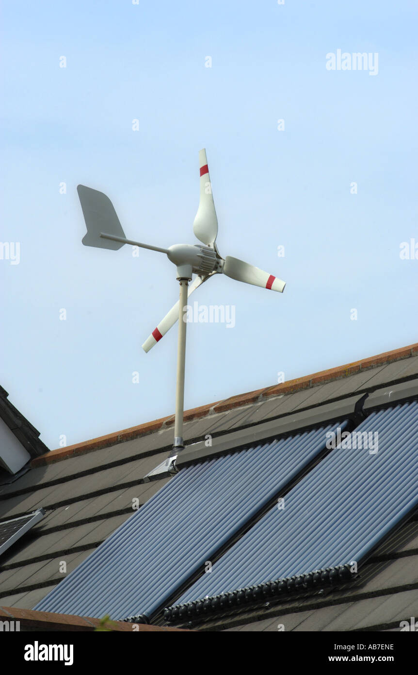 Micro Wind Turbine Solar Voltaic and Evacuated solar tubes on roof of house in Ferndown Dorset England Stock Photo