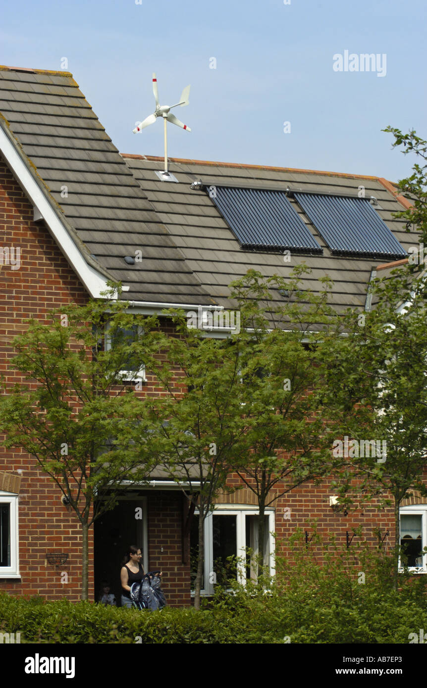 Micro Wind Turbine Solar Voltaic and Evacuated solar tubes on roof of house in Ferndown Dorset England - Stock Image