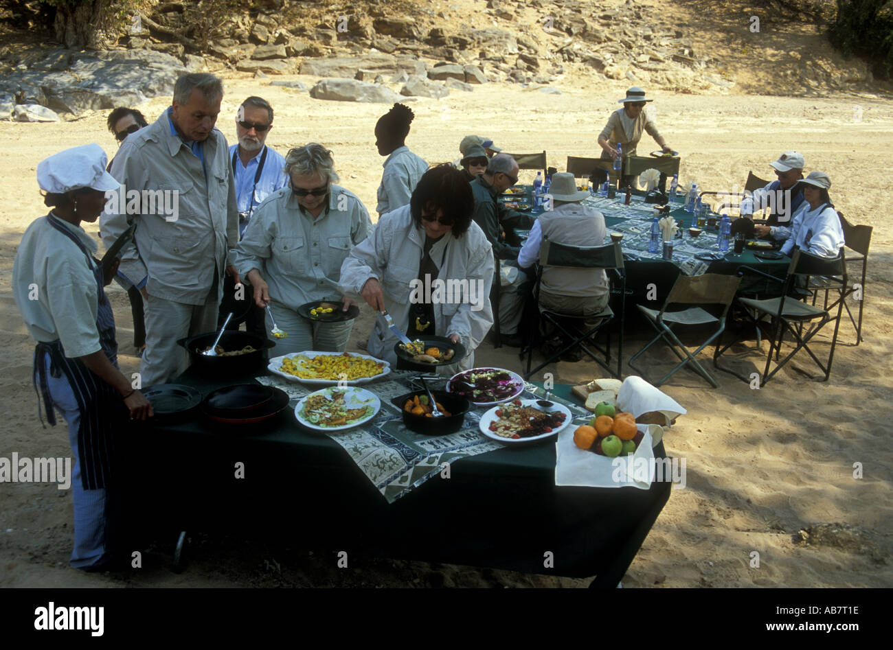 Guests of Damarland Lodge enjoying lunch in the dried out bed of the Huab River - Stock Image