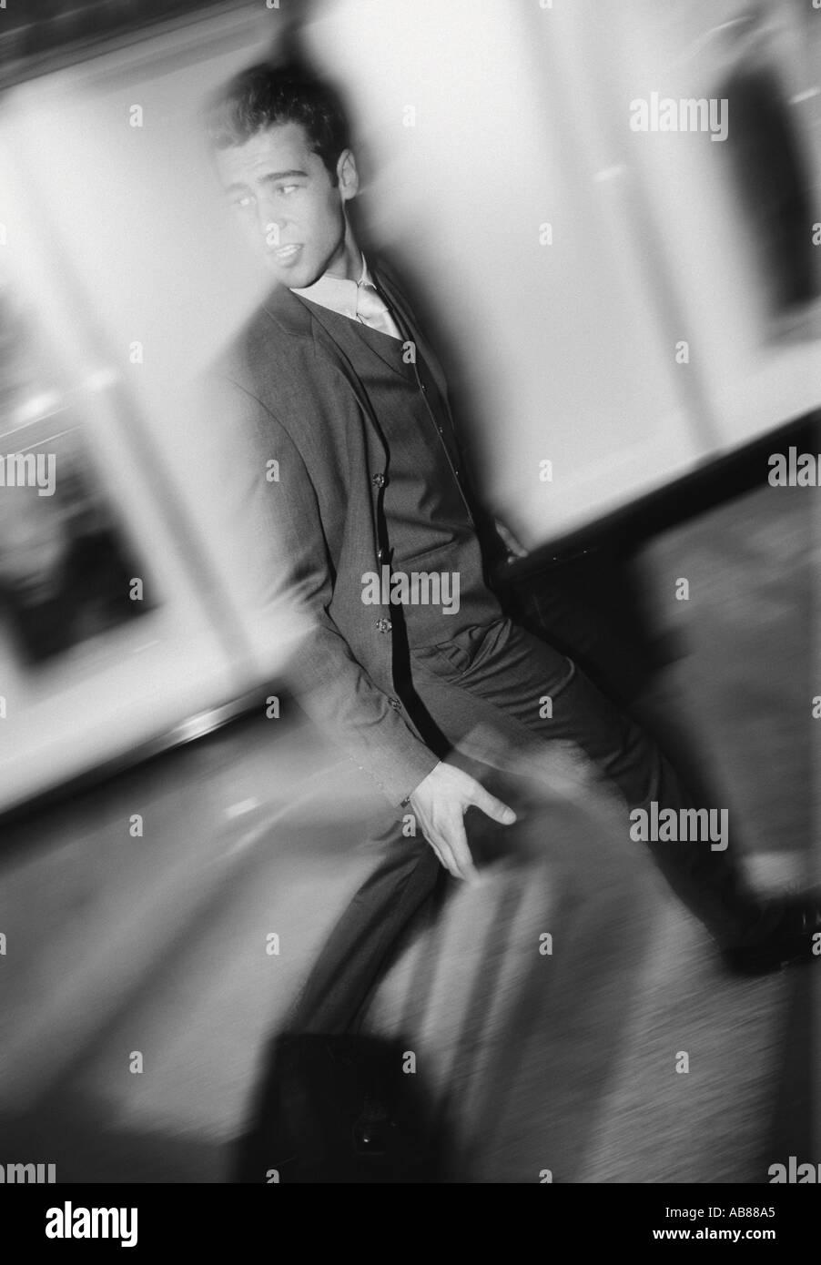 Businessman striding - Stock Image
