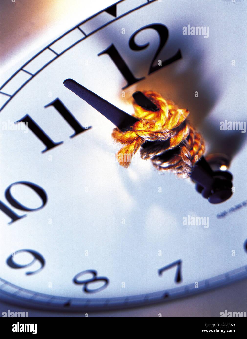 Tied clock hands - Stock Image