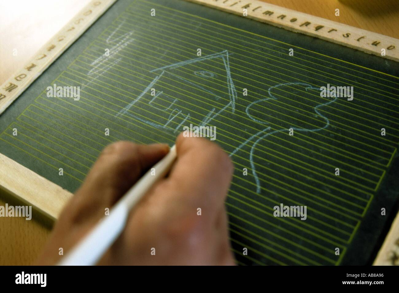 Person drawing on blackboard - Stock Image