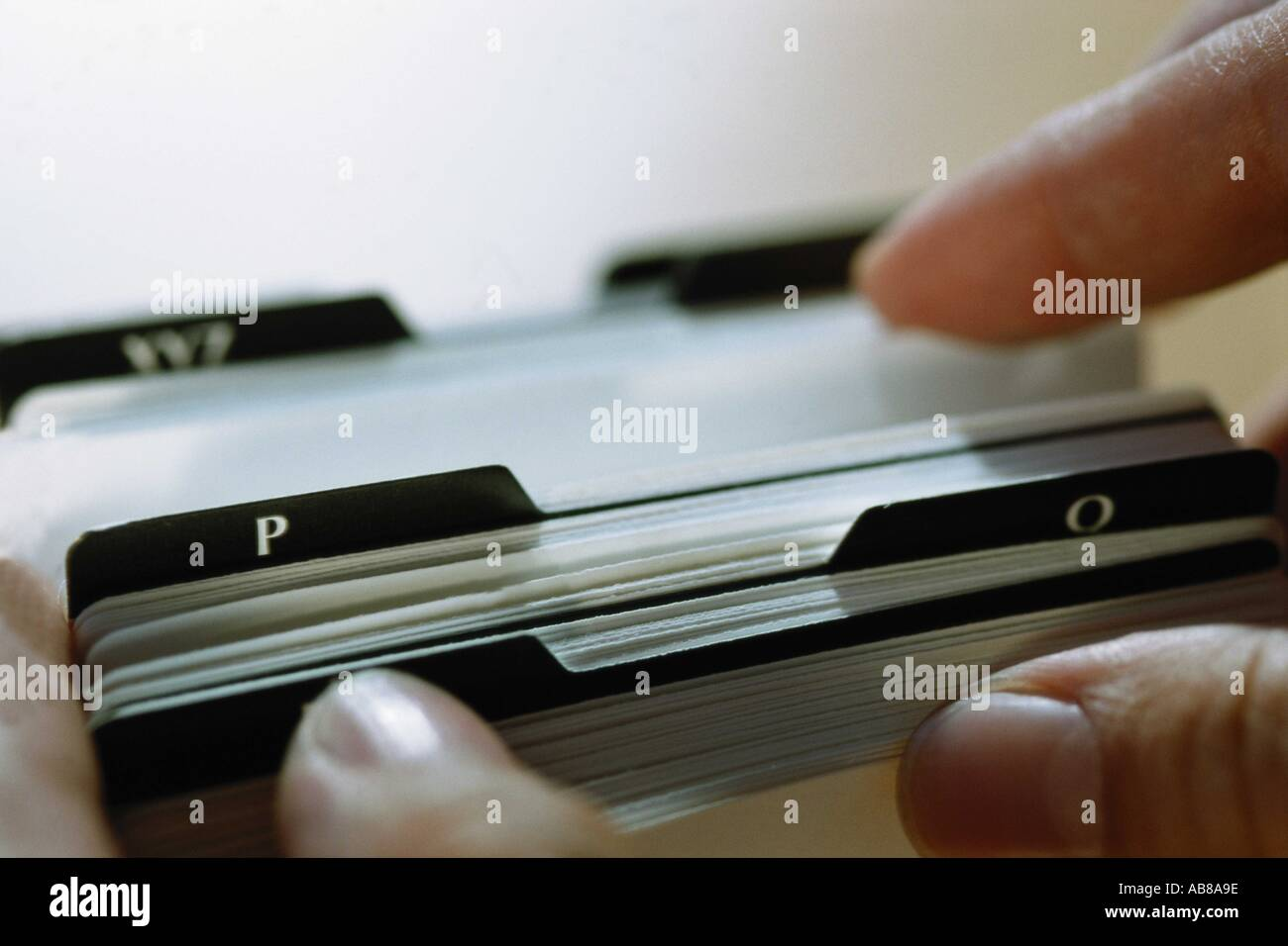 Looking through rotary card file - Stock Image