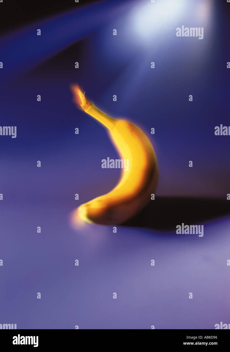 Banana on a blue background - Stock Image