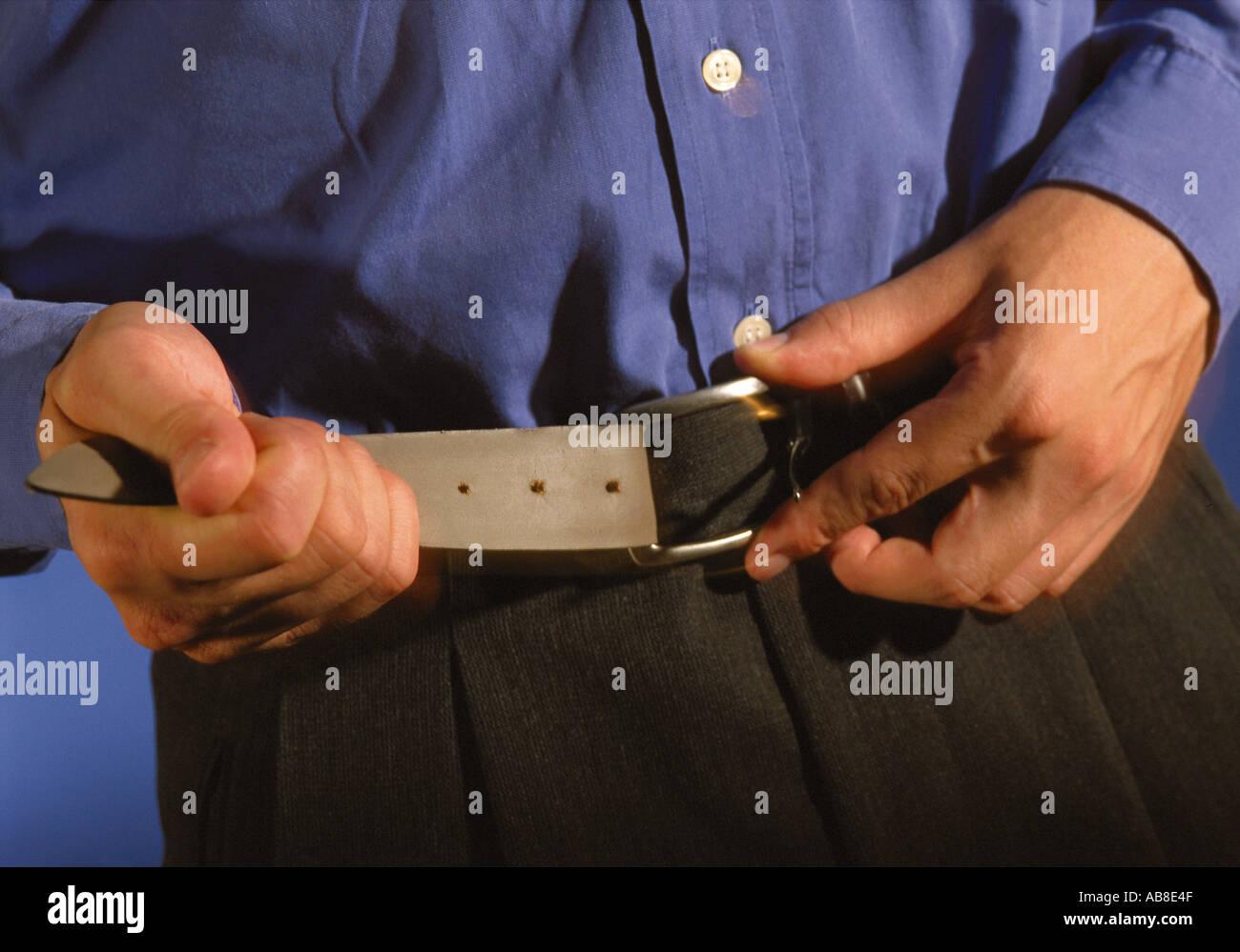 Tightening the belt - Stock Image
