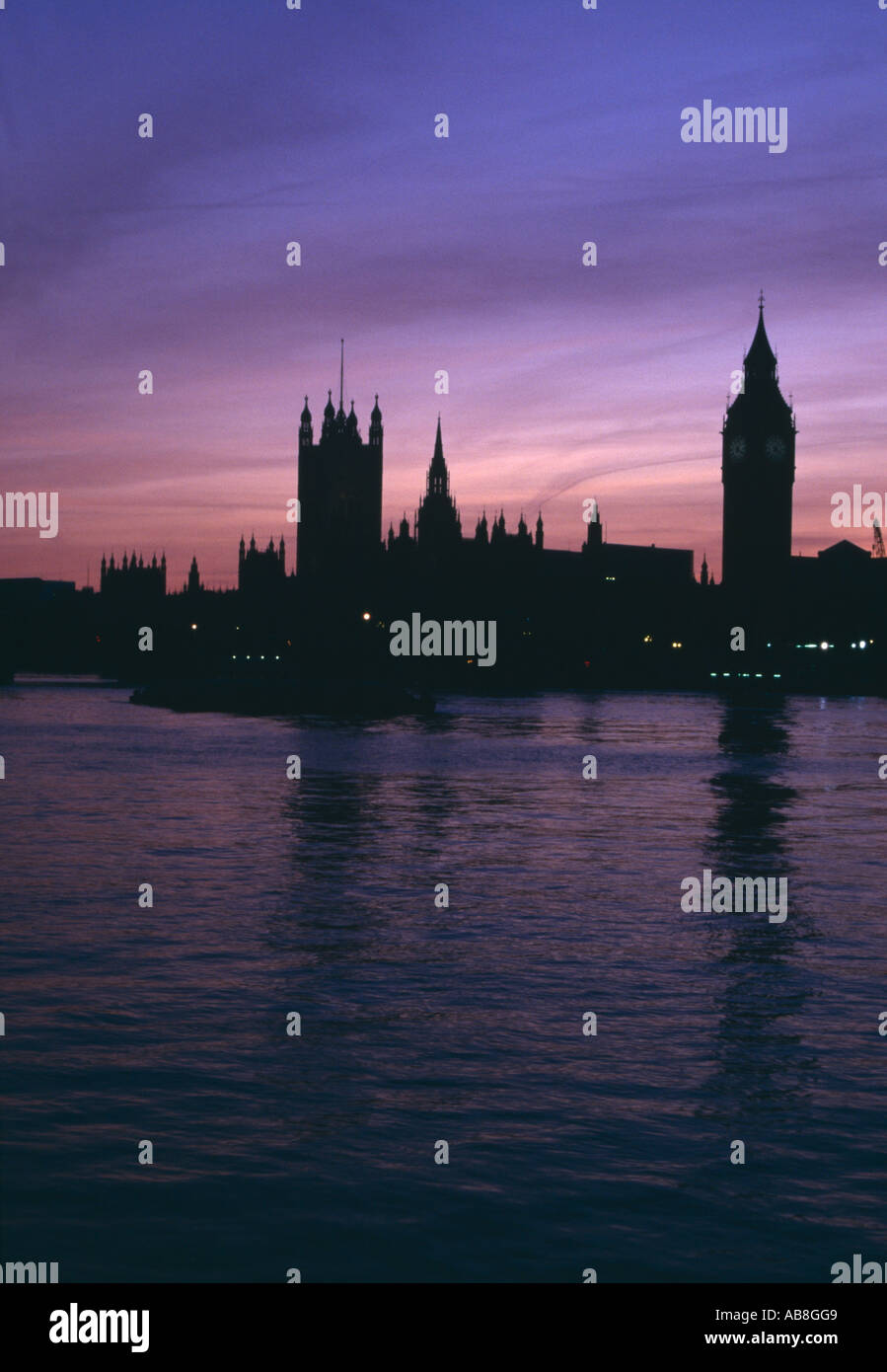 Houses of Parliament at Sunset, Westminster, London. Architect: Charles Barry, A. W. N. Pugin - Stock Image