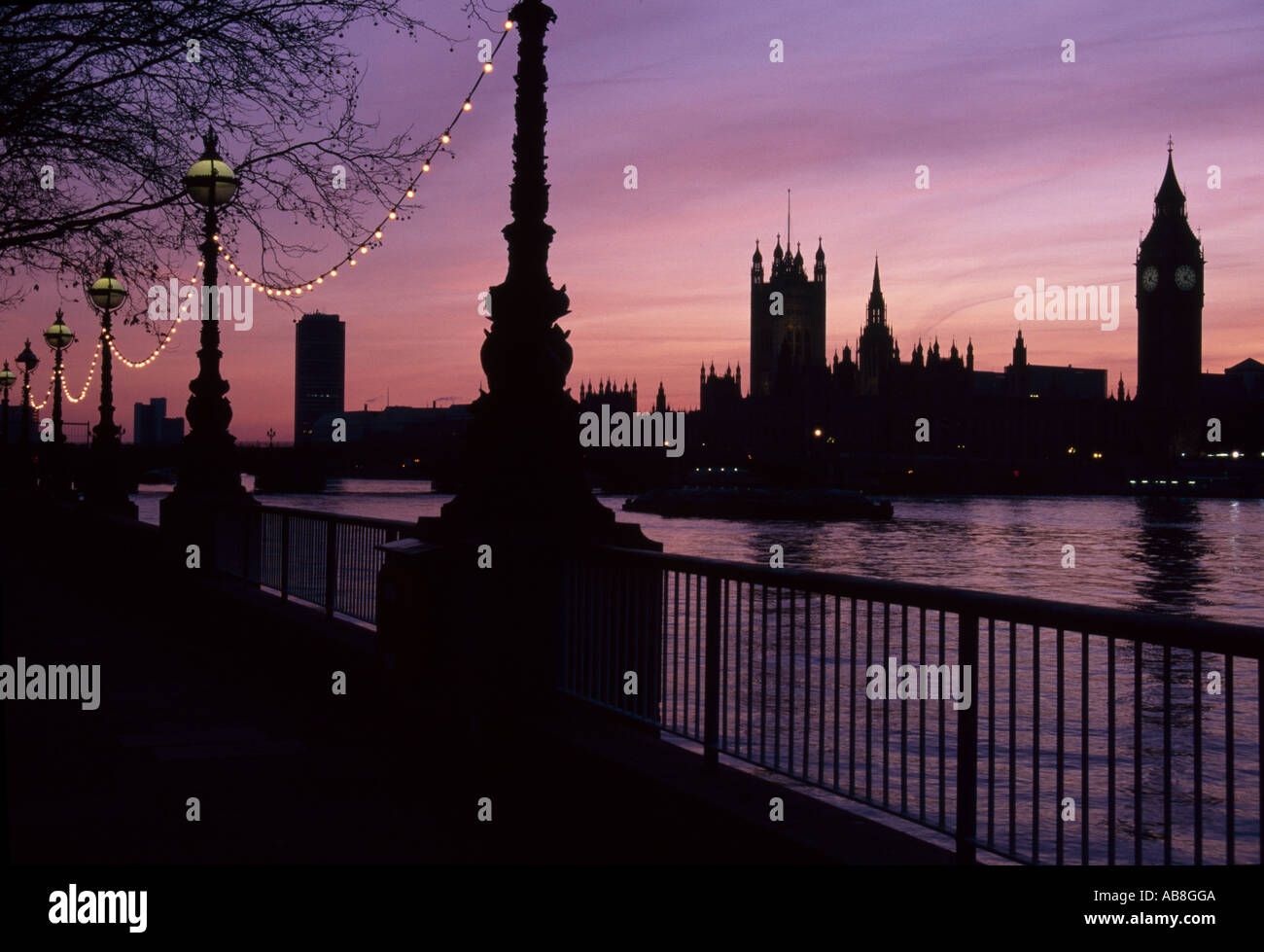 Houses of Parliament at Sunset, Westminster, London. South Bank of the River Thames. Architect: Charles Barry, A. W. N. Pugin - Stock Image