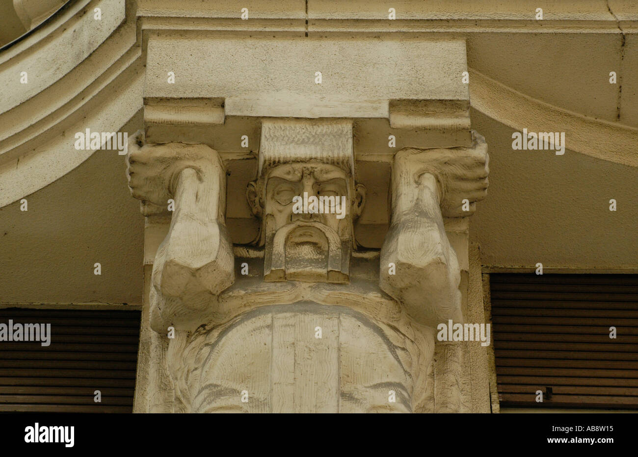 Figure supporting balcony around Vaci street Budapest Hungary - Stock Image