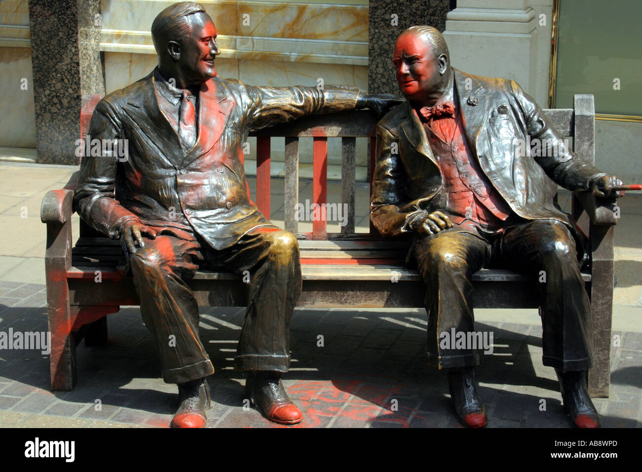 Paint vandalized Bronze sculptures of FD Roosevelt and Winston Churchill on bench New Bond Street London UK - Stock Image