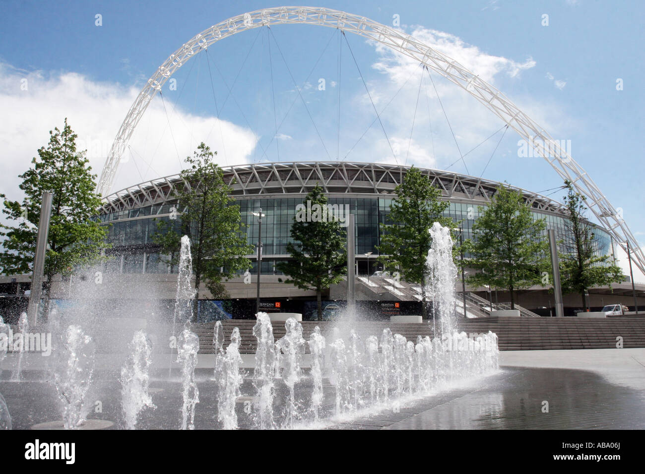 Wembley Stadium with fountain in foreground, North west London, England. As seen from outside Wembley Arena - Stock Image
