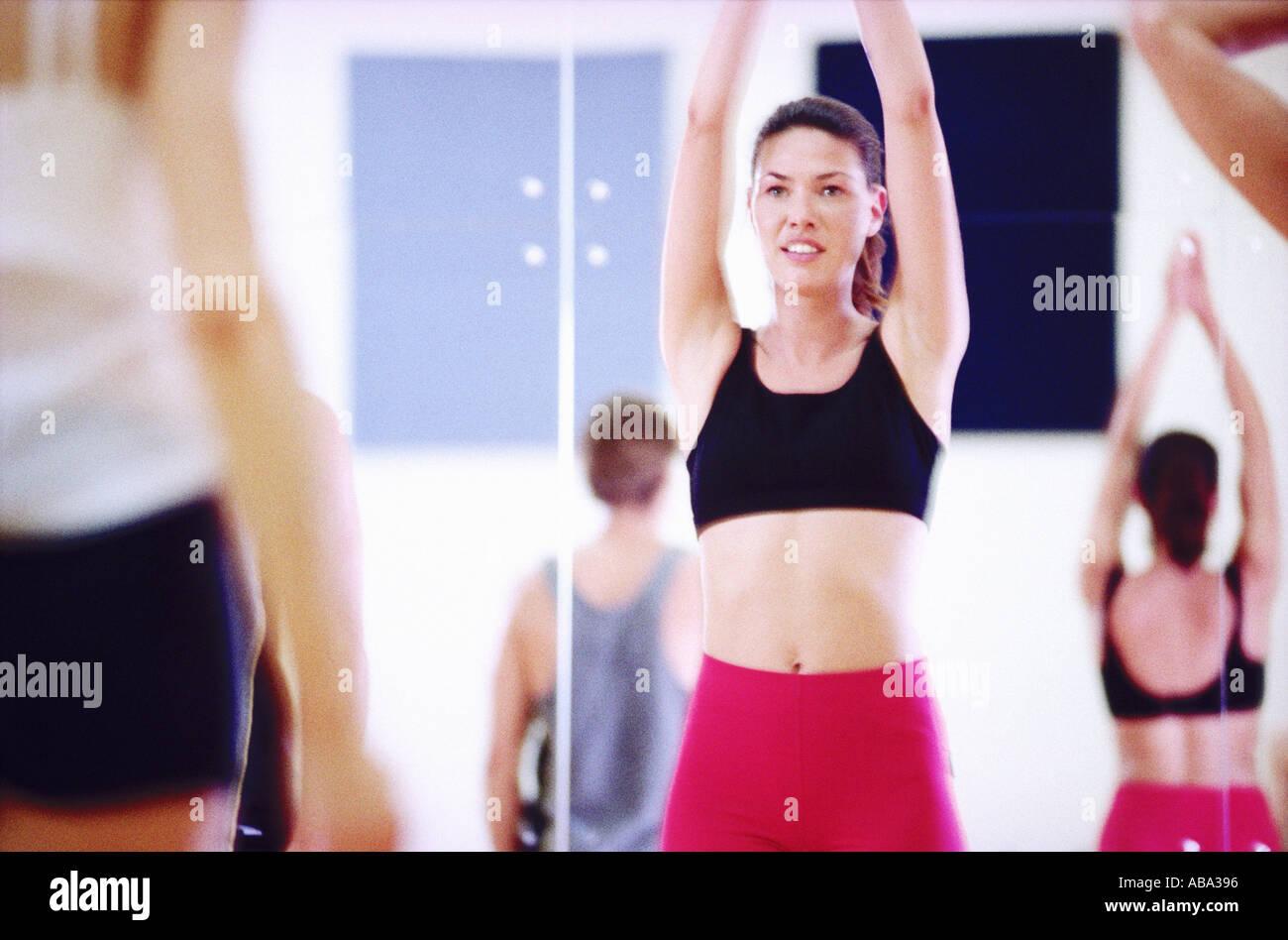 Young woman practising yoga - Stock Image