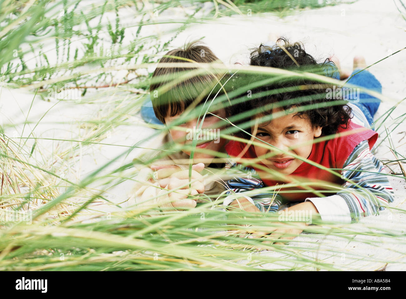 Boys playing hide-and-seek - Stock Image