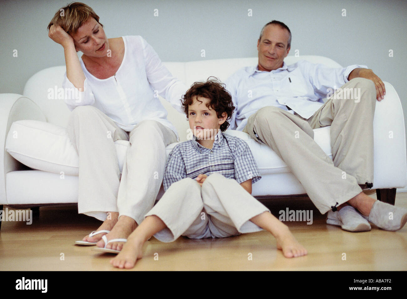 Trendy grandparents with grandson at home - Stock Image