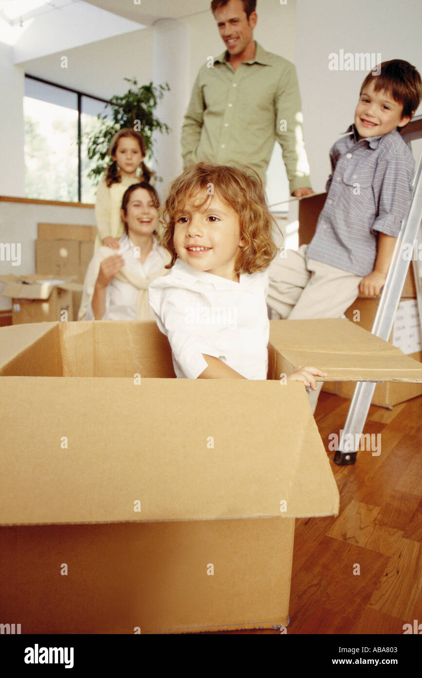 Young family unpacking in their new home - Stock Image