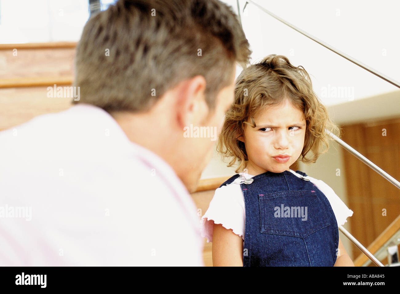 Father telling off naughty daughter Stock Photo