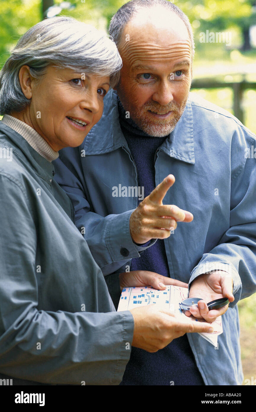 Couple with map - Stock Image