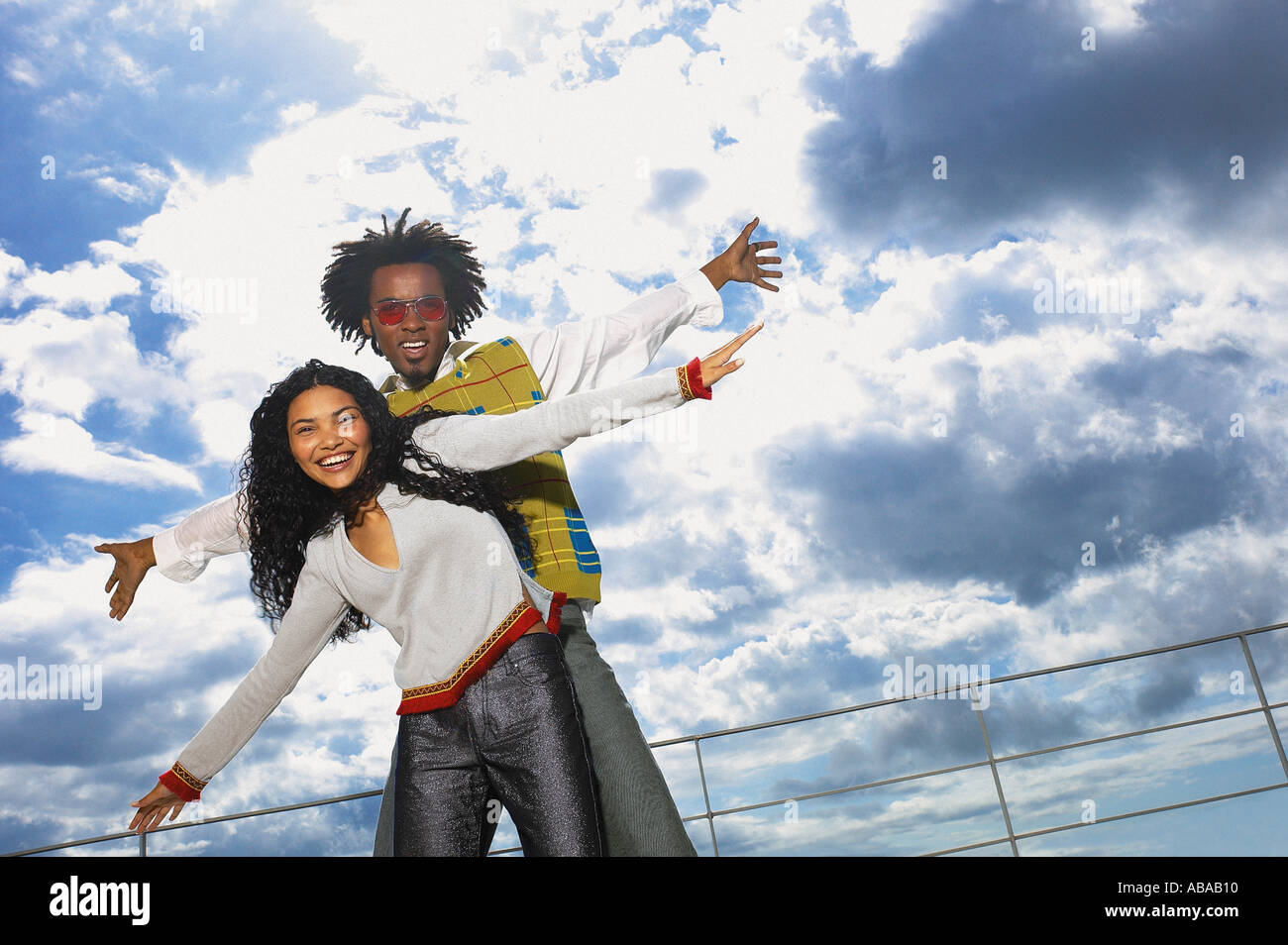 Man and woman with cloudy sky - Stock Image