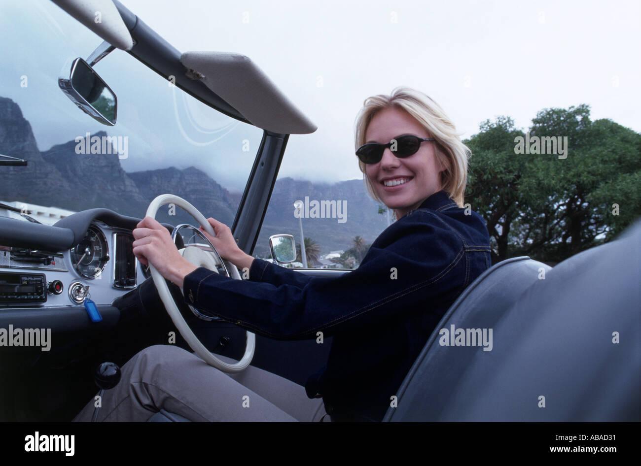 Girl driving car - Stock Image