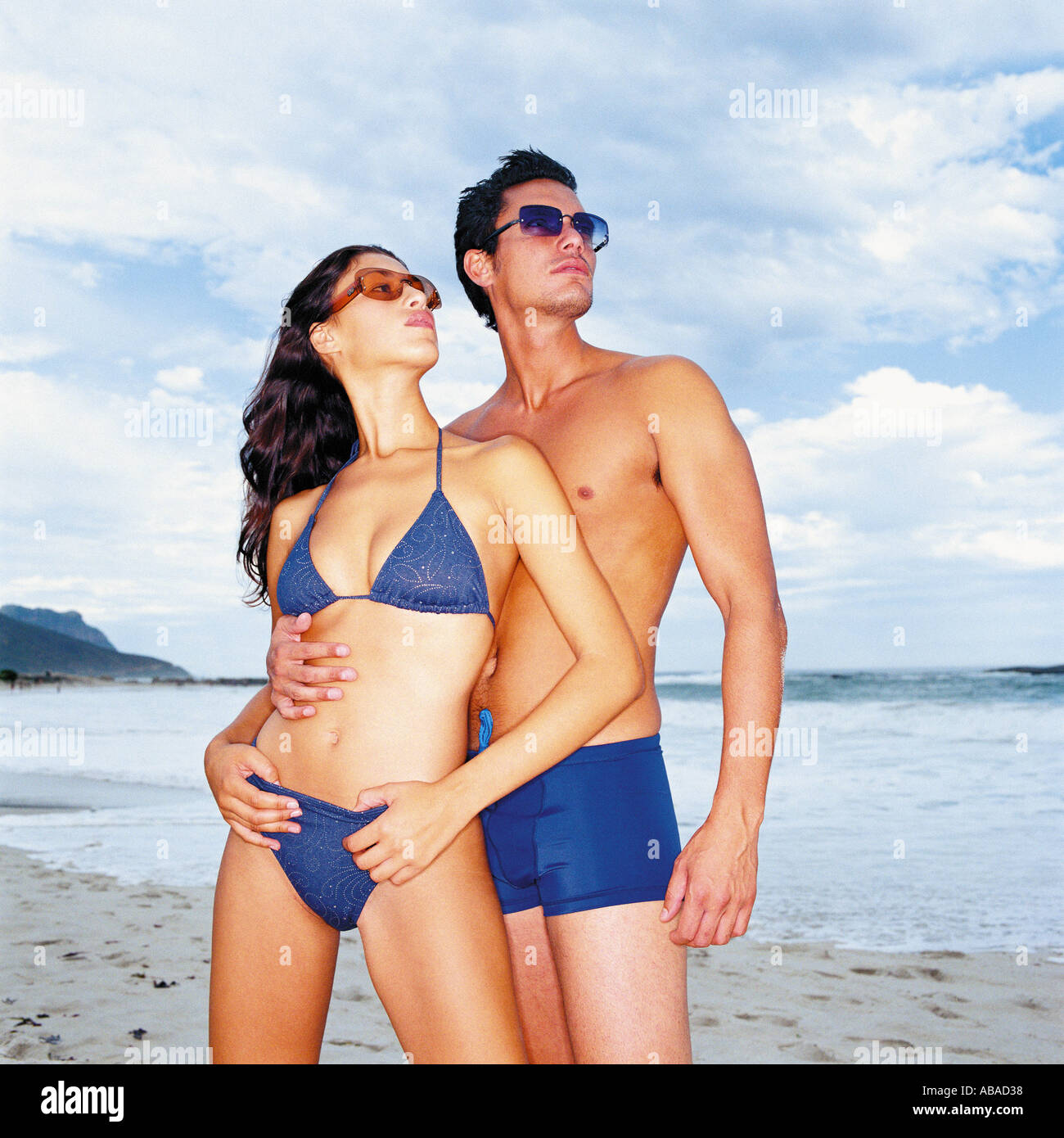 Man and woman on beach - Stock Image