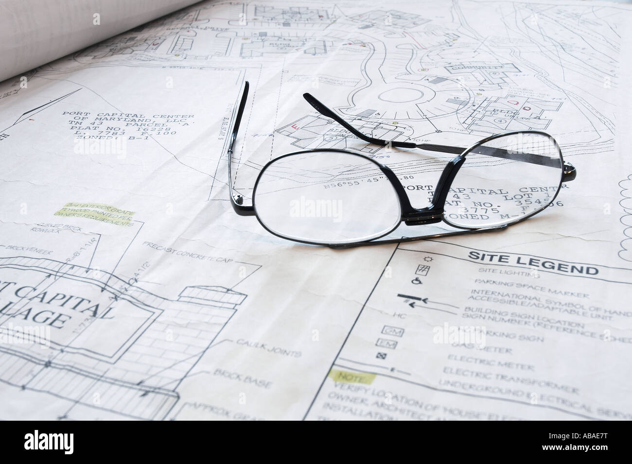 Architectural blueprint drawings of building on table with architectural blueprint drawings of building on table with architects eye glasses studio still life usa malvernweather Images