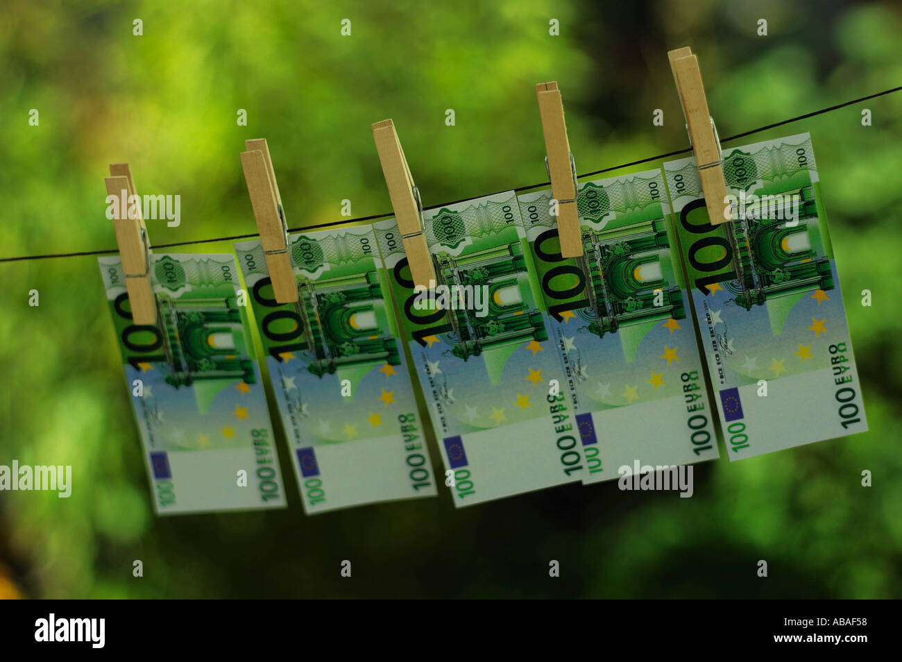 Money on clothes line Stock Photo