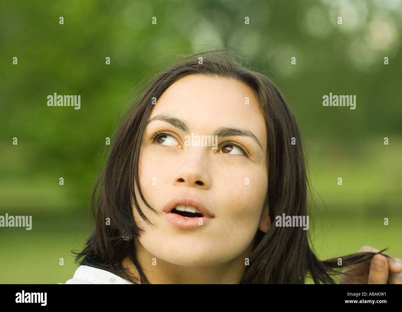 Woman looking up with mouth open - Stock Image