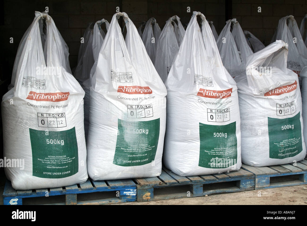 chemical fertilizer containers plastic bags in storage shed Stock