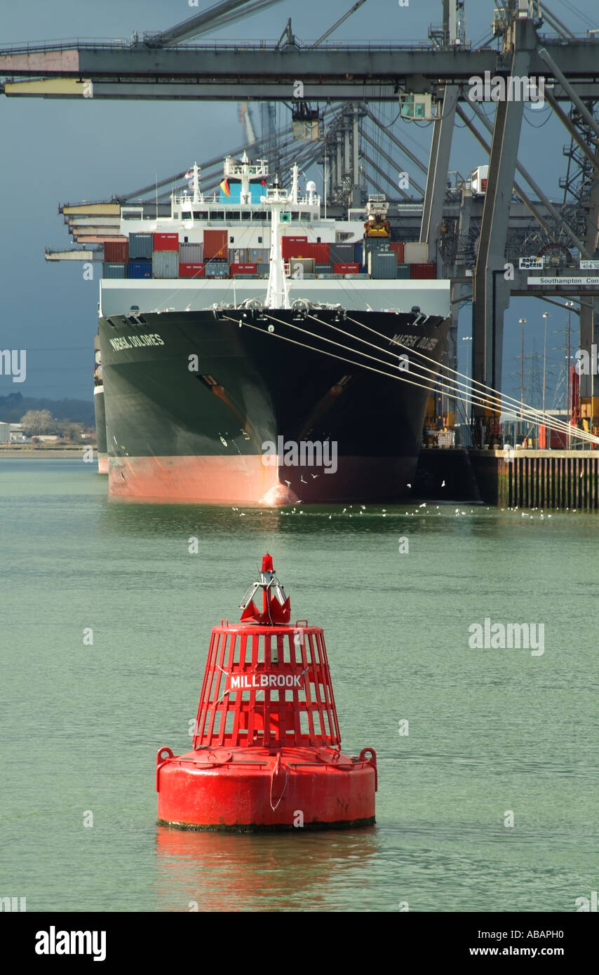Southampton Container Terminal southern England. SCT straddle carrier unloading container ships Stock Photo
