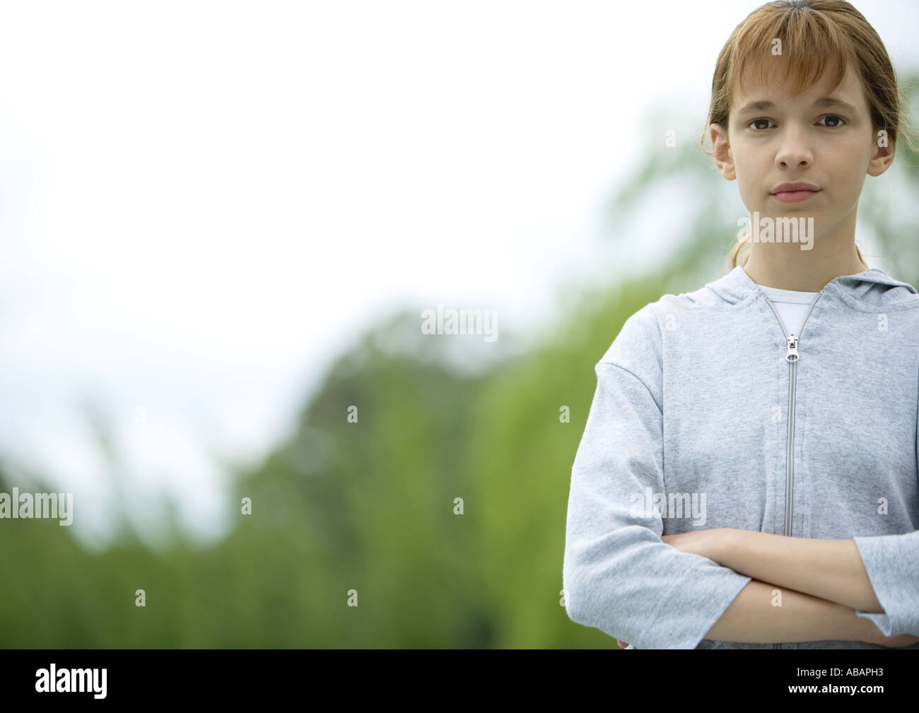 Girl with arms crossed - Stock Image