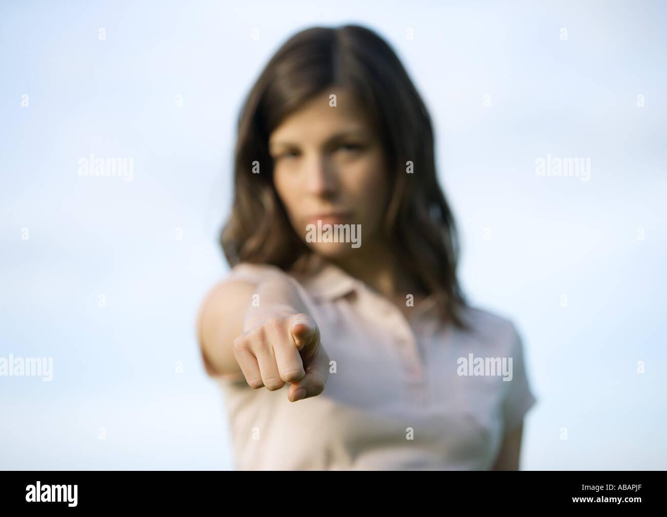 Woman pointing at camera - Stock Image
