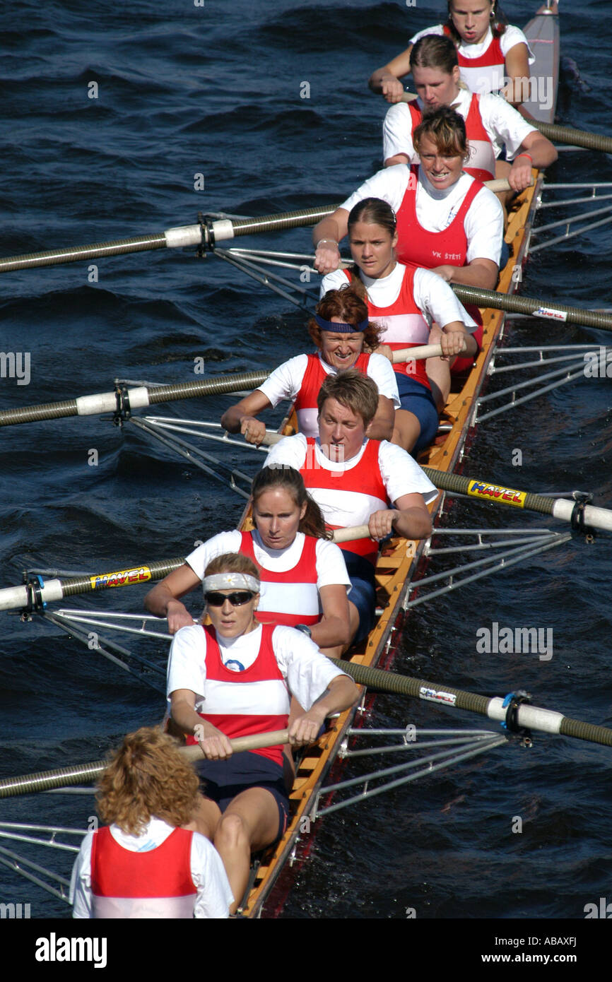 Female rowing team rowing ahead during a boat race on the River Vltava in Prague, Czech Republic, on September 24, - Stock Image
