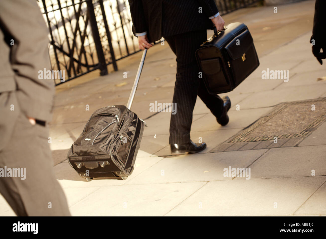 Businessman With Luggage - Stock Image