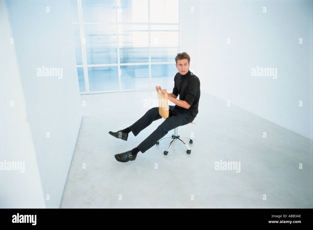 Office worker messing around - Stock Image